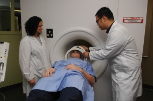 MRI Faculty and Students work on patient using simulator