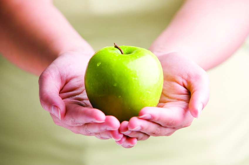 Two hands holding an apple, promoting Continuing Education Diabetes Program.