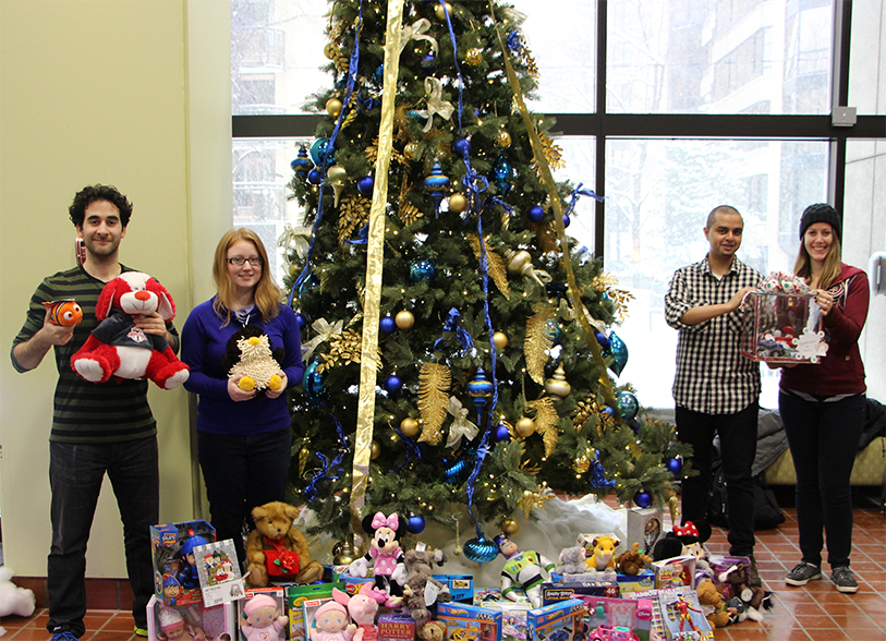 Members of the Michener Charity Committee with Toy Drive donations