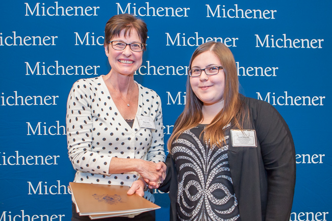 Danielle Nicole Grohn (right), winner of six scholarships, including the President Award, with professor Mary Emes.