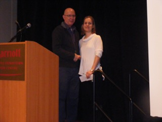 Mike Kiem (left) Treasurer of the Respiratory Therapy Society of Ontario (RTSO) awards 2015 respiratory therapy graduate Anna Nikolajewski with the RTSO Student Achievement Award