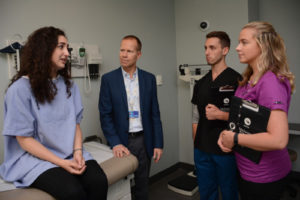Dr. Hodges works with patient actors to create a simulated clinical scenario and assess student performance