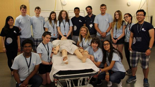 Judy Tran (far left, second row) and her DEEP Summer Academy students visit Michener's Centre for the Advancement of Simulation Education (CASE). (Photo: UHN)