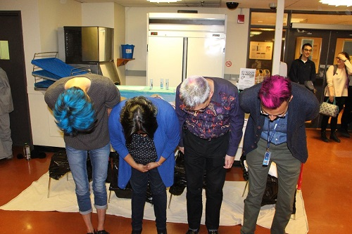 photo of faculty member bent over, showing the colour in their hair