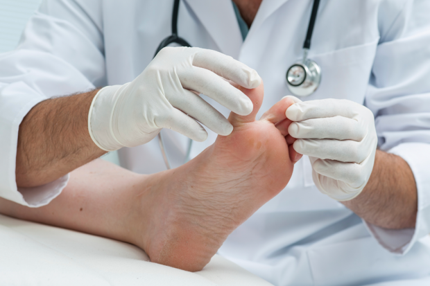 Chiropodist checking patients feet