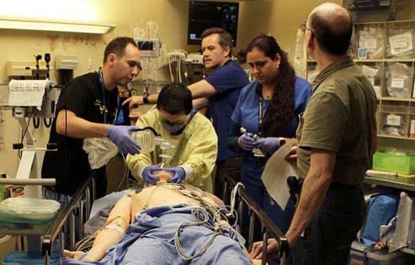 Health care team participates in simulation
