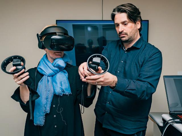 Two Michener staff using virtual reality equipment